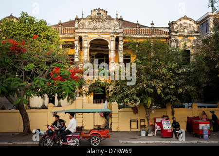 street scene and French colonial villa on Sothearos Street in downtown central Phnom Penh; Cambodia - Stock Photo