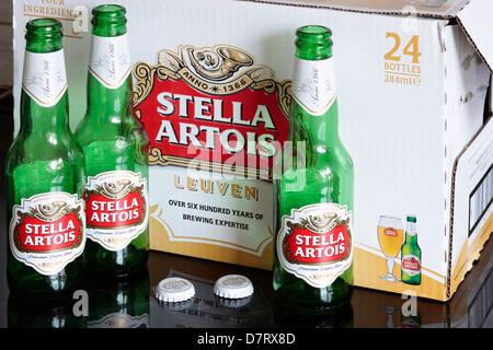 Three Bottles of Stella Artois against Box of 24 - Stock Photo