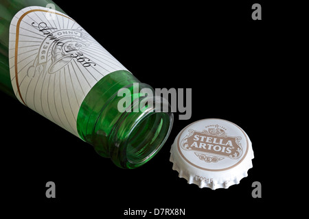 Open Bottle of Stella Artois with cap - Stock Photo