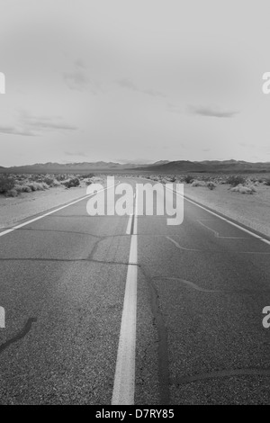 Road in the desert near Death Valley Junction; Nevada; USA - Stock Photo