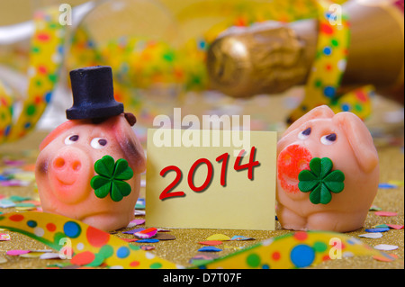 pig with clover leaf as talisman for new year 2014 - Stock Photo
