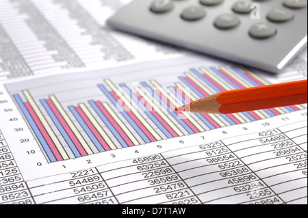 red pencil and financial calculator on business diagram - Stock Photo