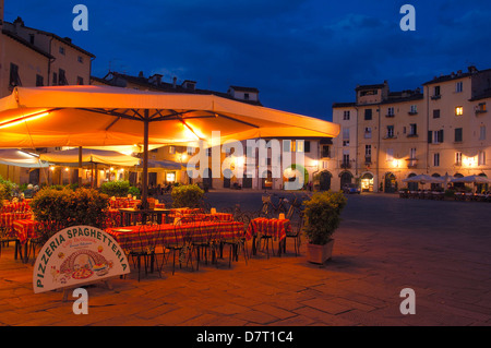 Lucca. Anfiteatro square at Dusk. Piazza Anfiteatro. Tuscany. Italy. Europe - Stock Photo