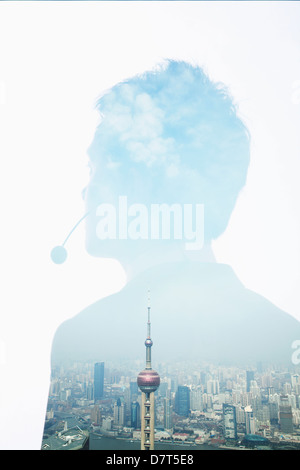 Double exposure of young businessman with headset and the skyline of Shanghai, China - Stock Photo
