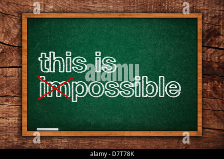 This is possible message hand written on a green chalkboard, motivational positive thinking concept of possible - Stock Photo