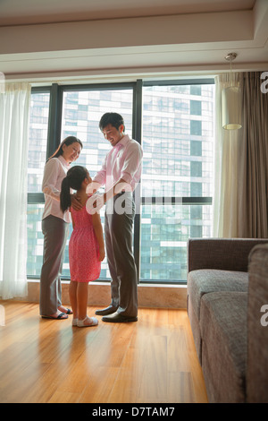 Family talking in the living room - Stock Photo