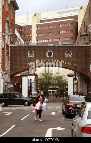 Brick arch over the road at the entrance to St Mary's hospital Paddington, London, May 2013 - Stock Photo