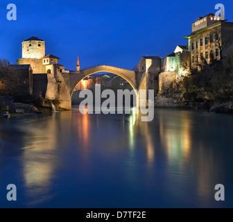 Old Bridge and Neretva river at dusk, Mostar, Bosnia and Herzegovina - Stock Photo