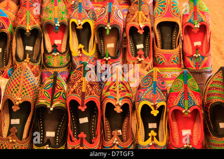 Display of colorful indian slippers, Rajasthan, India - Stock Photo
