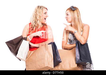 Two ecstatic girlfriends shopping, isolated on white background