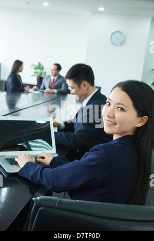 Businesswoman Looking Over Her Shoulder at the Camera - Stock Photo