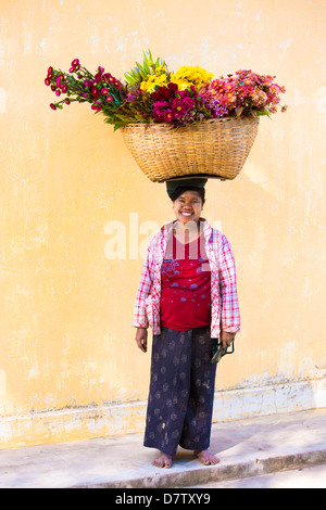 Local woman with thanakha traditional face painting, Shwezigon Paya, Nyaung U, Burma - Stock Photo