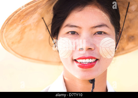 Backlit portrait of local woman wearing traditional clothing, near Mandalay, Burma - Stock Photo