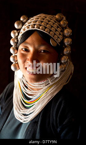 Woman of the Akha tribe in traditional dress, in a hill village near Kengtung (Kyaingtong), Shan State, Burma - Stock Photo