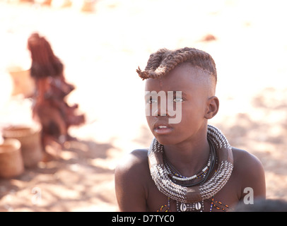 Young Himba boy with plaited hair, Kunene Region (formerly Kaokoland) in the far north of Namibia - Stock Photo