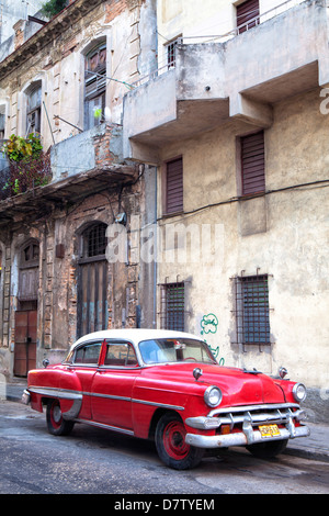 Red vintage American car parked on a street in Havana Centro, Havana, Cuba, West Indies - Stock Photo