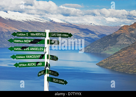 All directions sign post, Queenstown, Otago, South Island, New Zealand - Stock Photo