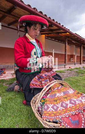 a woman in traditional dress knitting wool hats in the