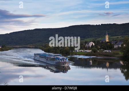 River cruise ship on the Moselle River in the late afternoon light, Germany - Stock Photo