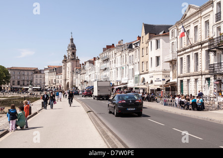 People walk along the waterfront at the port in La Rochelle, France - Stock Photo
