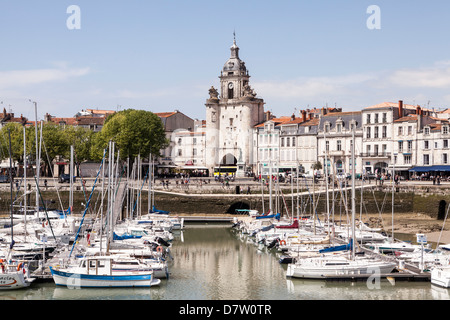 A view of the waterfront and the Gate of the Large Clock (Porte de la Grosse Horloge), in La Rochelle, France - Stock Photo