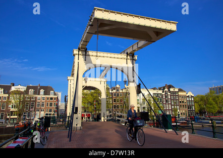 Cyclist on the Magere Brug (Skinny Bridge), Amsterdam, Netherlands - Stock Photo
