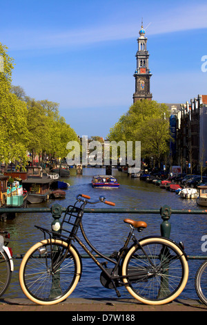 Westerkerk Tower and Prinsengracht Canal with bicycle, Amsterdam, Netherlands - Stock Photo
