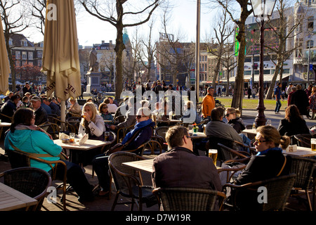 People drinking at cafe in Rembrandtplein, Amsterdam, Netherlands - Stock Photo