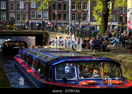 Tourist boat on Leliegracht, Amsterdam, Netherlands - Stock Photo