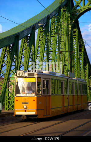 Liberty Bridge and tram, Budapest, Hungary - Stock Photo