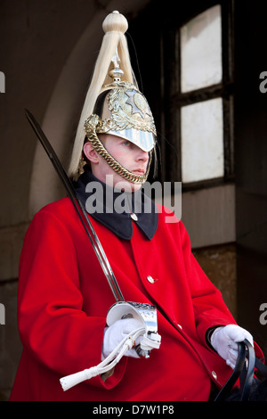 Mounted Household Cavalry guard outside entrance to Horseguards Parade, Whitehall, London, England, United Kingdom - Stock Photo