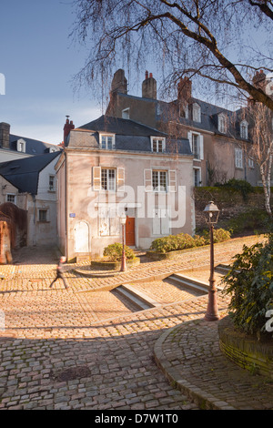 People walking through the old part of the city of Angers, Maine-et-Loire, France - Stock Photo