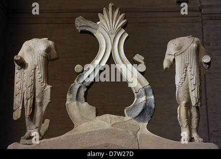 West pediment of the Temple of Aegina. Two women and a large palmette and tendrils ornament. Ca. 500 BC. Glyptothek. - Stock Photo