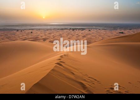 Sunset at Erg Chebbi Desert from the top of a 150m sand dune, Sahara Desert near Merzouga, Morocco, North Africa - Stock Photo