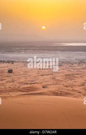Erg Chebbi Sahara Desert sunset from the top of a 150m sand dune, near Merzouga, Morocco, North Africa - Stock Photo