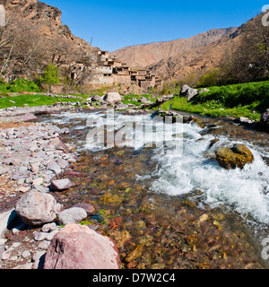 River running past Tizi n Tamatert and a Berber village, High Atlas Mountains, Morocco, North Africa - Stock Photo