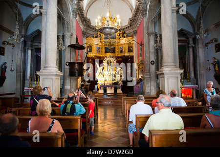 Tourists inside the Church of St. Blaise, Dubrovnik Old Town, UNESCO World Heritage Site, Dubrovnik, Croatia - Stock Photo