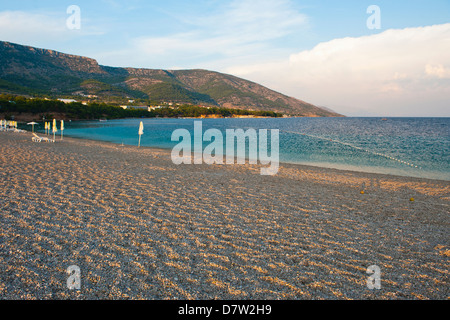Zlatni Rat Beach at sunset, Bol, Brac Island, Dalmatian Coast, Adriatic, Croatia - Stock Photo