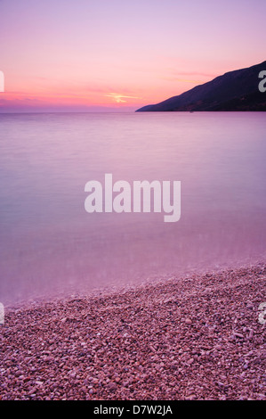 Adriatic Sea at Zlatni Rat Beach at sunset, Bol, Brac Island, Dalmatian Coast, Croatia - Stock Photo