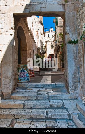 Narrow side street, Hvar Town, Hvar Island, Dalmatian Coast, Croatia - Stock Photo