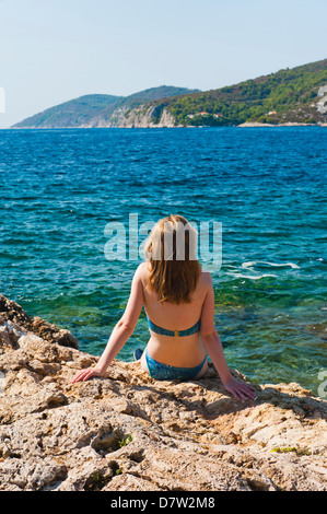 Hvar Town, tourist on a beach, Hvar Island, Dalmatian Coast, Adriatic, Croatia - Stock Photo