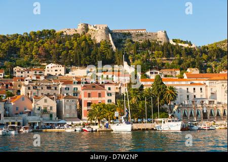 Hvar Town and Fortica (Spanish Fort), seen from the Adriatic Sea, Hvar Island, Dalmatian Coast, Croatia - Stock Photo