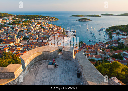 Hvar Town and tourists at Hvar Spanish Fort (Fortica) at sunset, Hvar Island, Dalmatian Coast, Adriatic, Croatia - Stock Photo