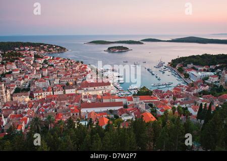 Hvar Town at sunset taken from the Spanish Fortress (Fortica), Hvar Island, Dalmatian Coast, Adriatic, Croatia - Stock Photo