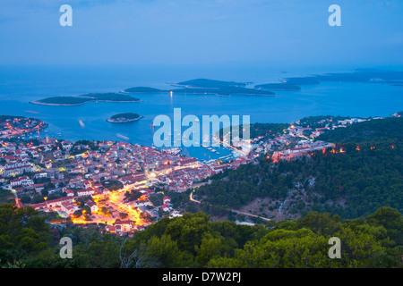 Hvar Town and the Pakleni Islands (Paklinski Islands) at night, Dalmatian Coast, Adriatic Sea, Croatia - Stock Photo