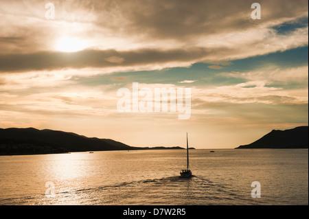 Sailing boat at sunset on the Dalmatian Coast, Adriatic, Croatia - Stock Photo