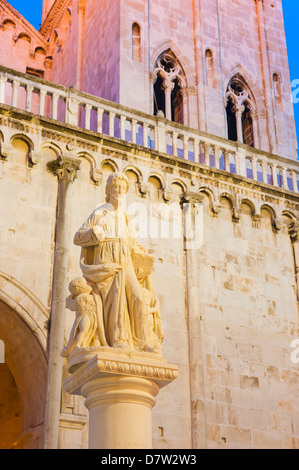 St. Lawrence statue outside the Cathedral of St. Lawrence at night, Trogir, UNESCO World Heritage Site, Dalmatian - Stock Photo
