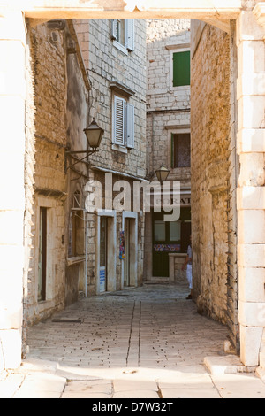 Cobbled streets of Trogir seen through the South Town Gate, Trogir, UNESCO World Heritage Site, Dalmatia, Croatia - Stock Photo