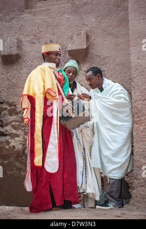 Priest holding relics from the Bete Medhane Alem Church, Lalibela, Amhara region, Northern Ethiopia - Stock Photo
