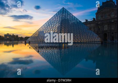 Louvre Pyramide at sunset, Paris, France - Stock Photo